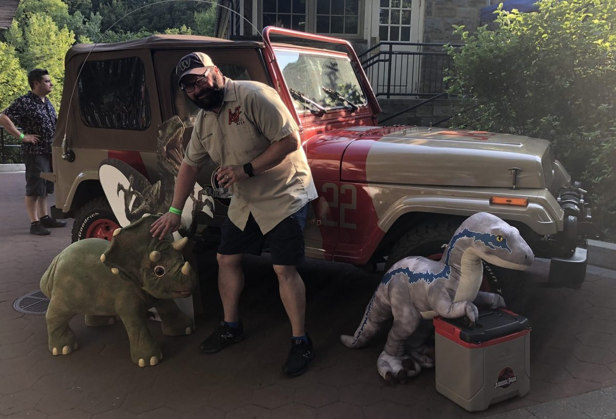 Jeff with some dino friends and a Jurassic Park Jeep